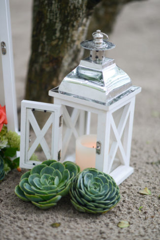 large white lantern with candle inside