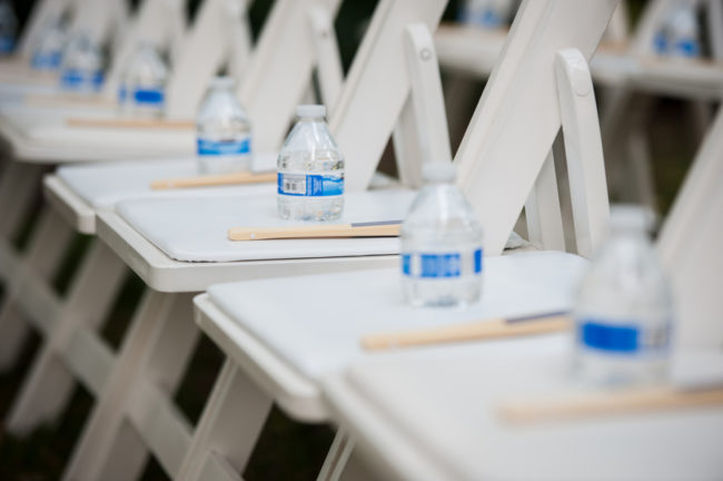 hand fans and bottled water on ceremony seats