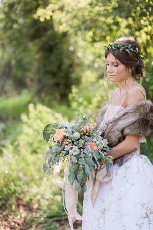 Bride Wearing Faux Fur Wrap Holds Bouquet