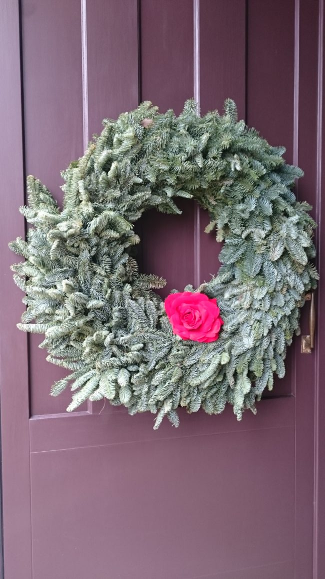 wreath on purple door