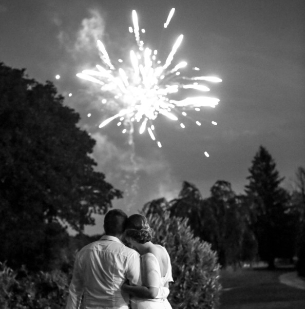 newlywed couple watch fireworks