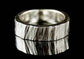 a handcrafted ring inspired by the german wedding tradition of log cutting need we say more - German Wedding Rings