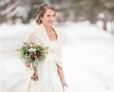 winter bride wearinng warm wrap shawl