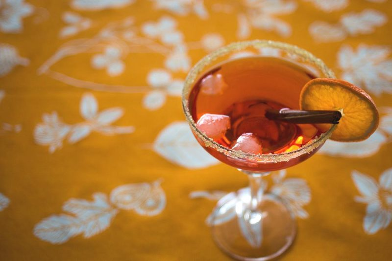 citrus and aperol cocktail with cinnamon and orange slice