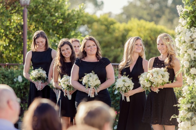 bridesmaids in cocktail length black dresses