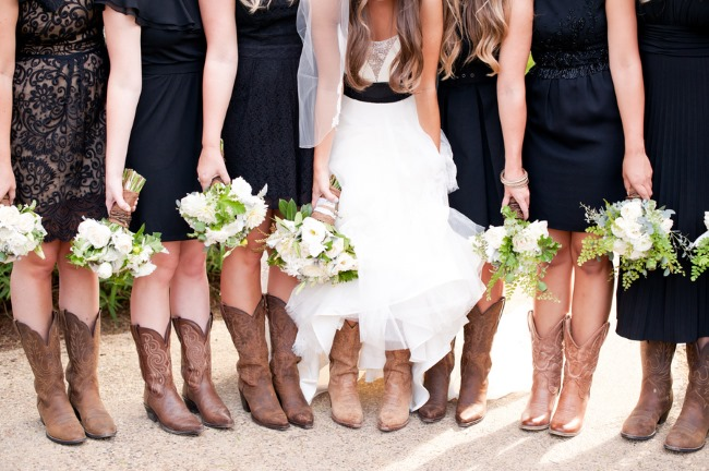 Bridesmaids-wearing-black-mismatched-bridesmaids-dresses-with-cowboy-boots