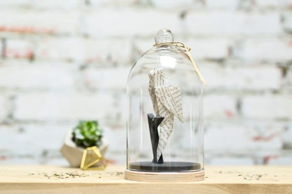 origami parrot under glass bell
