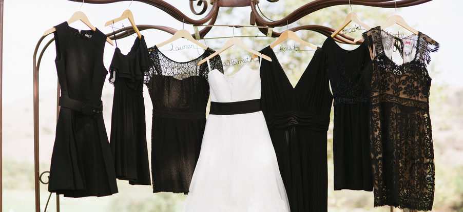 black bridesmaid dresses hanging on custom hangers