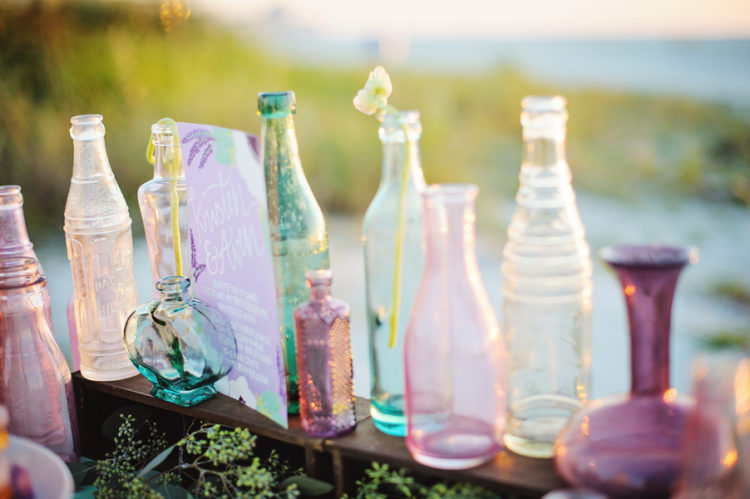 multiple colored glass bottles decor