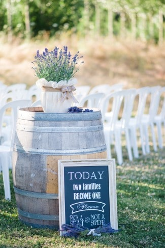 lavender plant in burlap atop wine barrel