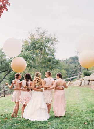 bridesmaids with geronimo balloons