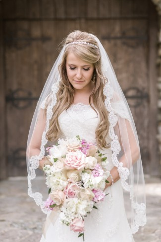 bride holds blush pink bouquet