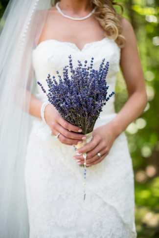bride holds fresh lavender bridal bouquet