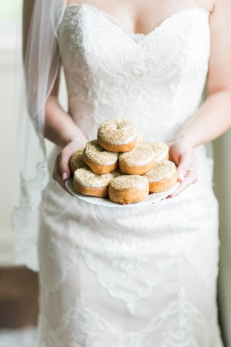 bride holds plate of donuts