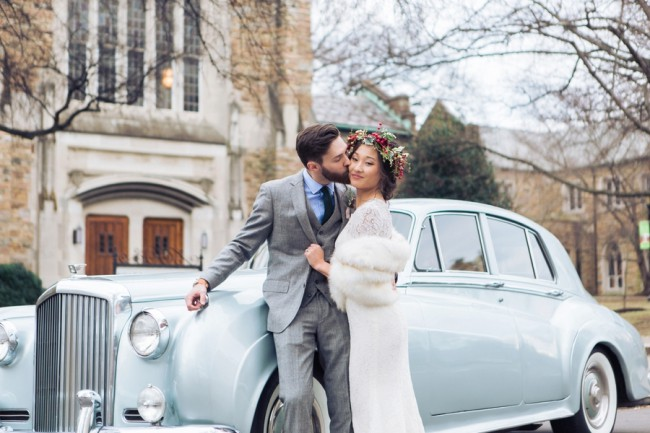 couple in front of vintage rollsroyce
