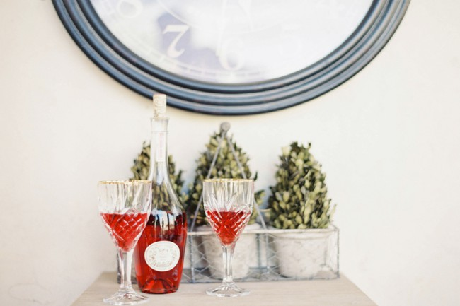 crystal glasses + decanter with red drink