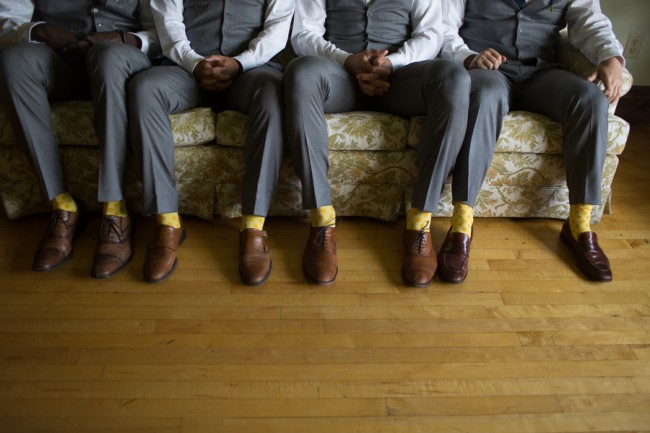 groomsmen in matching yellow socks