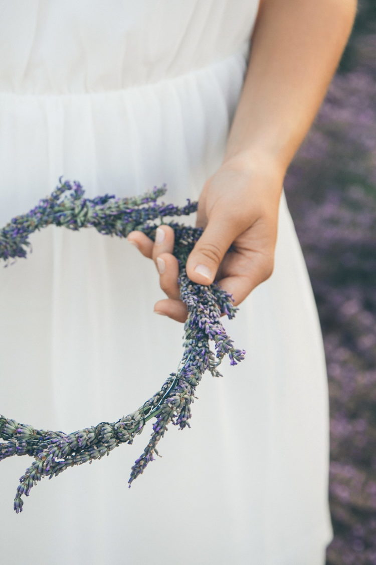 bride holding dried lavender floral crown