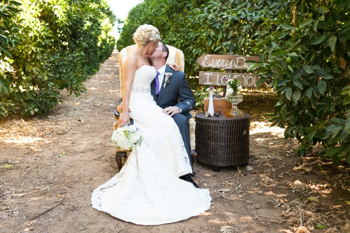 kissing-on-vintage-chair-among-vines