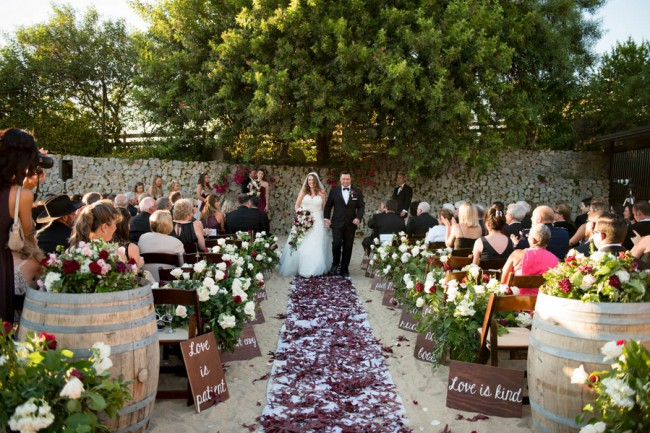 backyard wedding ceremony with petal aisle
