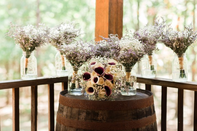 bouquets on wine barrel