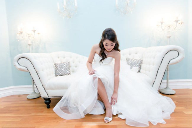 bride on couch at Villa Amore