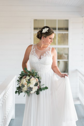 bride on porch with bouquet