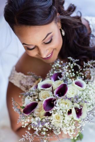 bride with white purple bouquet