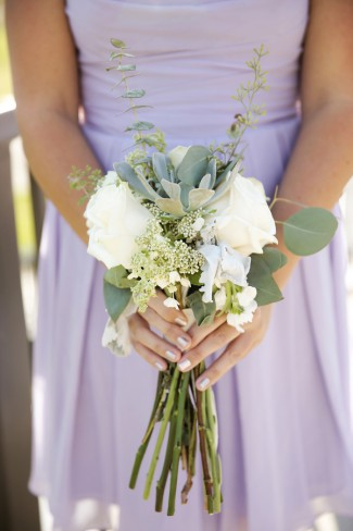 bridesmaid holds bouquet