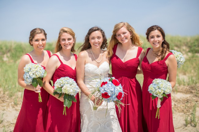 bridesmaids in bright red dresses
