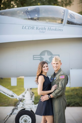 couple in front of jet