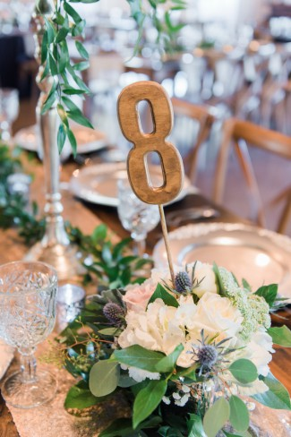gold table number in thistle centerpiece