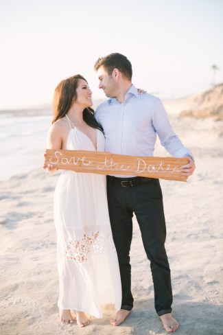 holding save the date wood plank