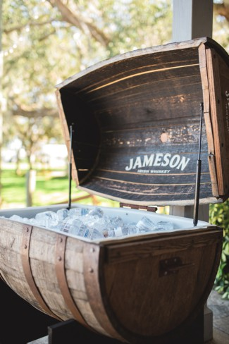 jameson whisky barrel with water bottles