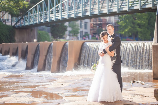 newlyweds by river in greensville
