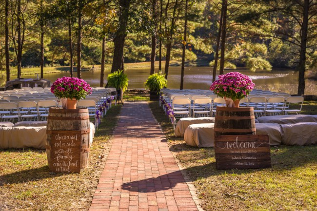 outdoor ceremony with wine barrel at entrance