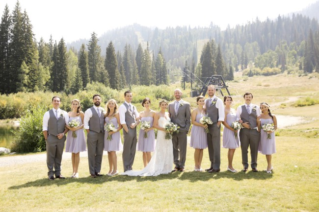 outdoor photo of bridal party with mountain background
