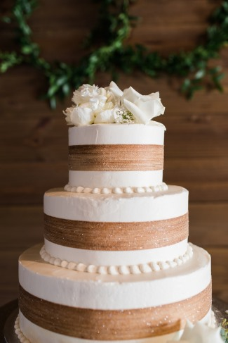 three tier cake with gold ribbons