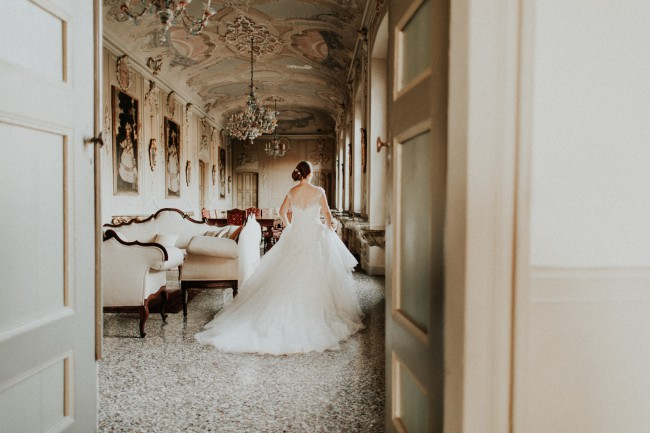 bride in ornate room at Villa