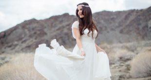 bride-twirling-wedding-dress-in-califonia-desert