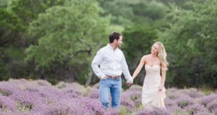 couple walk in lavender rows