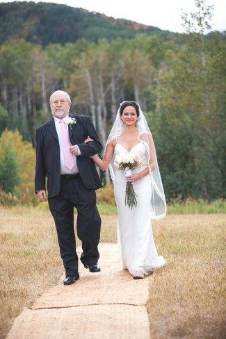 father with bride in ruffled lace knee length veil