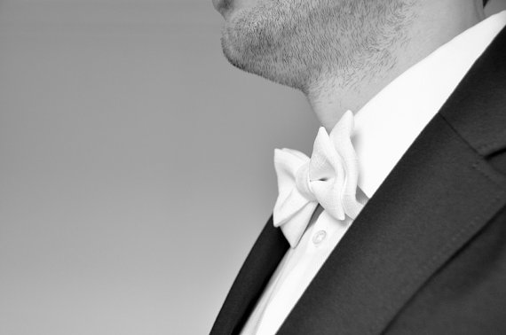 groom wearing formal White Bow Tie