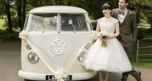 newlyweds beside vintage VW van