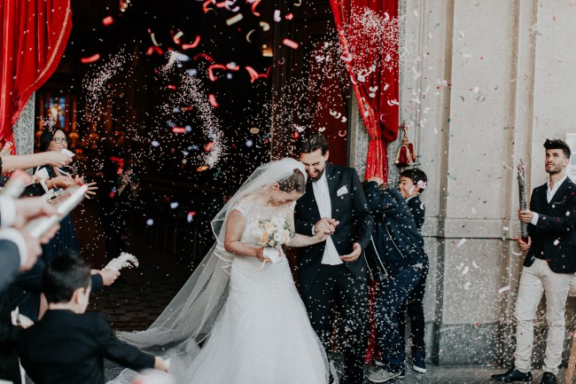newlyweds depart church with confetti flying