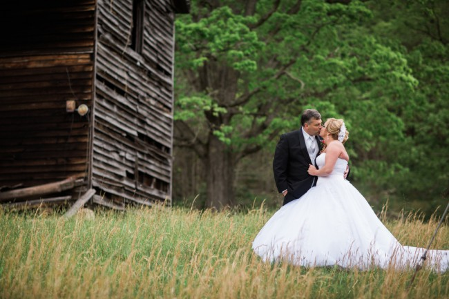 newlyweds near old wood shed