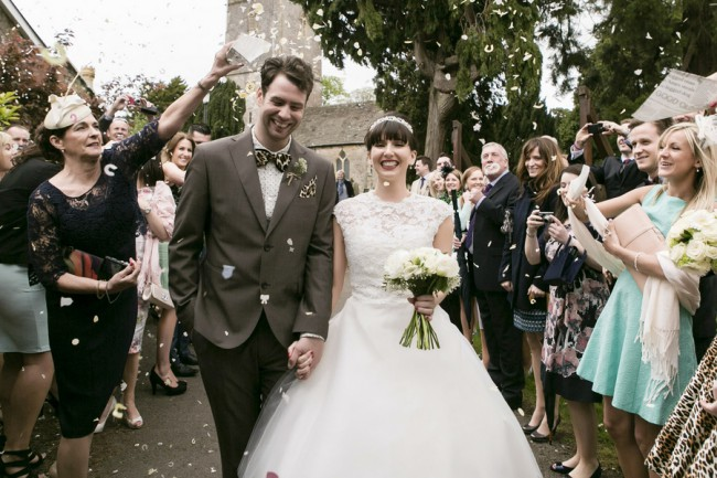 newlyweds outside church with petal confetti