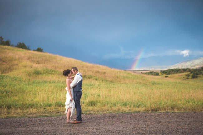 newlyweds with rainbow in background