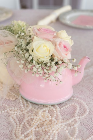 pink tea kettle centerpiece with babys breath