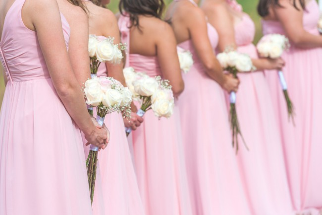 row of bridesmaids in pink dresses